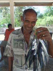 Fish vendor in Lautem, Timor Leste