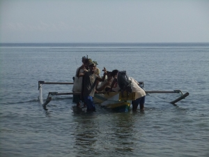 Spear fishermen heading out to catch the low tide, Com, Timor Leste