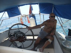 Captain Hans at the helm