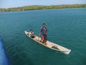 Our first friends in the channel.  They paddled that boat for 4 hours every day to tend their crop