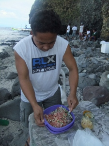 Mixing raw tuna for kinilaw on a beach in Anilao.