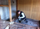 Jack-hammering concrete to make way for a new staircase.