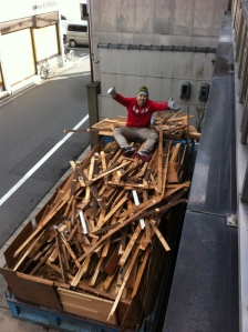 Yusuke-san on a pile of debris ready to be sent to the recycle center.